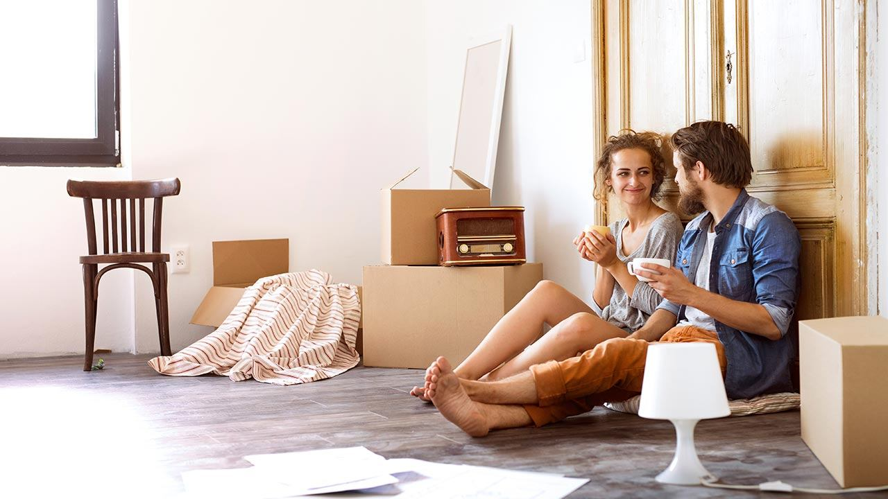 young couple moving new house free interior space